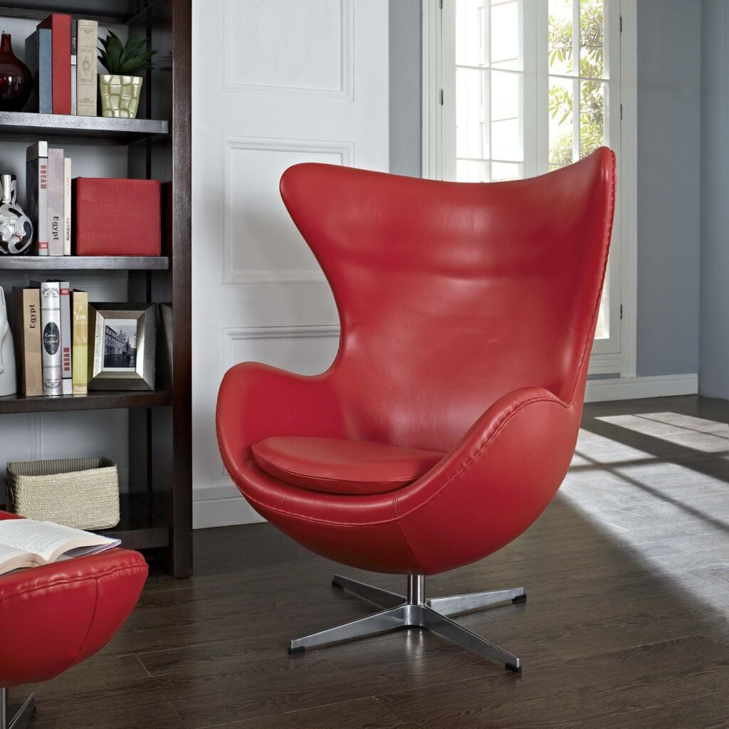 egg chair in red color and steel details